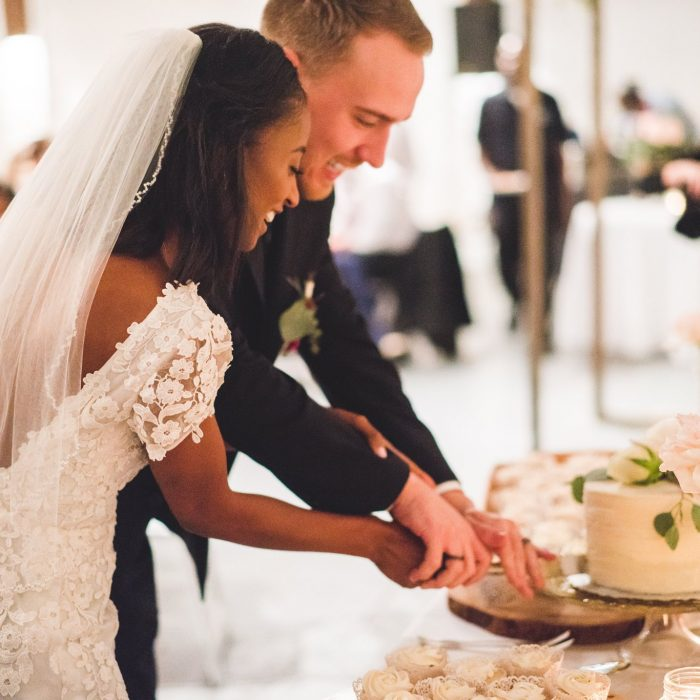 happy atlanta bride and groom cutting cake
