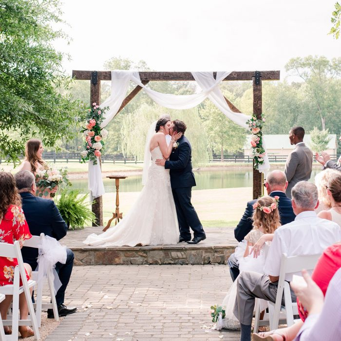 Bride and groom kissing during ceremony in Atlanta Georgia